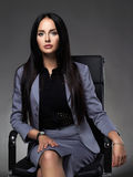 Business woman sitting on chair Royalty Free Stock Photography