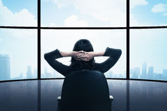 Business woman sitting on the chair looking the window Royalty Free Stock Image