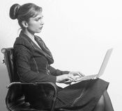Business woman sitting on chair with notebook in office Stock Images