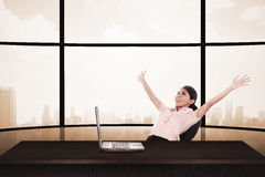 Business woman sitting on the chair with raise hand and laptop Stock Image