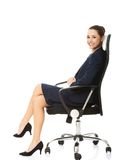 Business woman sitting in chair. Stock Photo