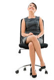 Business woman sitting on a chair Royalty Free Stock Image
