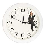 Business woman sitting on clock Royalty Free Stock Image