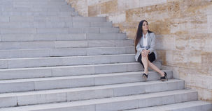 Business woman sitting with crossed legs Royalty Free Stock Photography