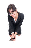 Business woman sitting on crouches and holding smartphone Royalty Free Stock Photos