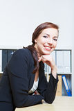 Business woman sitting at desk Royalty Free Stock Photos