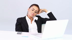 Business woman sitting at the desk stock video