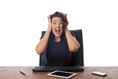 Business woman sitting at desk at the office Royalty Free Stock Photos
