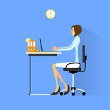 Business woman sitting at desk in office working Royalty Free Stock Image
