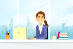 Business Woman Sitting at Desk in Office Working Stock Photo