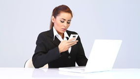 Business woman sitting at the desk and talking phone stock video footage