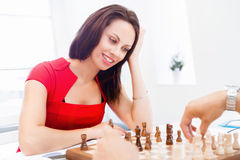 Business woman sitting in front of chess Royalty Free Stock Images