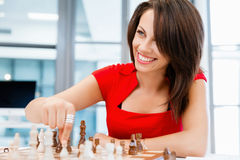 Business woman sitting in front of chess Royalty Free Stock Photos