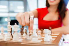 Business woman sitting in front of chess Stock Photography