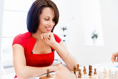 Business woman sitting in front of chess Royalty Free Stock Image