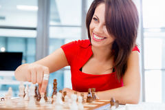 Business woman sitting in front of chess Royalty Free Stock Photo