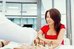 Business woman sitting in front of chess Stock Photo