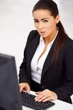 Business woman sitting in front of computer monitor Stock Image