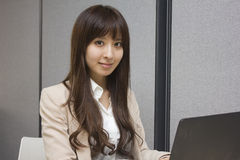 Business woman sitting in front of Laptop computer in office Stock Photo