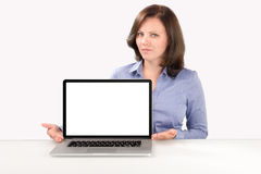 Business woman is sitting in front of a laptop Stock Photos