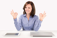 Business woman is sitting in front of a laptop and a tablet Stock Image