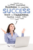 Business woman is sitting in front of a laptop under success emo. Business woman is sitting under success emotions bubble in front of a modern laptop and raising Royalty Free Stock Image