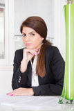Business woman sitting with hair tied in ponytail Royalty Free Stock Photo