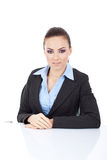 Business woman sitting at her desk Royalty Free Stock Photography