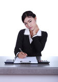 Business woman sitting on her desk holding a pen working with do Stock Photography