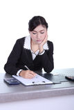 Business woman sitting on her desk holding a pen working with do Royalty Free Stock Photography