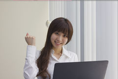 Business woman sitting at her desk with Laptop computer in office Royalty Free Stock Image