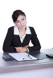 Business woman sitting on her desk and thinking with documents s Stock Image