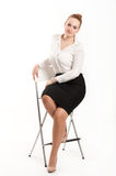 Business woman sitting on  high chair. Business woman sitting on a high chair Royalty Free Stock Photo
