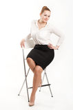 Business woman sitting on  high chair. Business woman sitting on a high chair Stock Images