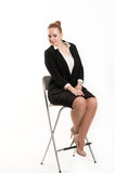 Business woman sitting on  high chair. Business woman sitting on a high chair Royalty Free Stock Photography