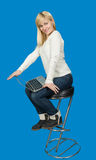 Business woman sitting a high chair and works on Royalty Free Stock Photos