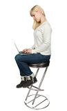 Business woman sitting a high chair and works on Stock Photos