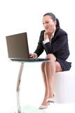 Business woman sitting at the laptop Royalty Free Stock Photos
