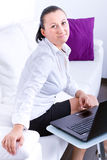 Business woman sitting with laptop Stock Photo