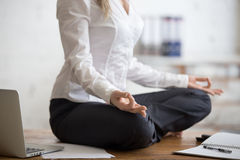 Business woman sitting in lotus pose Stock Images