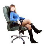 Business woman sitting on luxury office armchair Royalty Free Stock Images