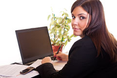 Business woman sitting in office Royalty Free Stock Image