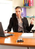Business woman sitting in the office. In front of the laptop Royalty Free Stock Photo