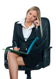 Business woman sitting in office chair Royalty Free Stock Photos