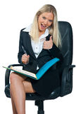 Business woman sitting in office chair Stock Images