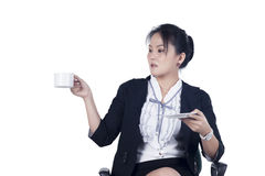 Business woman sitting in office chair with a cup of coffee Stock Photo