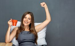 Business woman sitting in office chair with pillow. And coffee cup. Working break concept portrait stock images