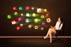 Business woman sitting in office chair with tablet and colorful Royalty Free Stock Photos