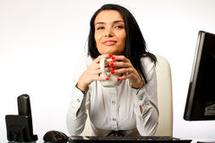 Business woman sitting at office desk Stock Photography