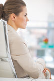 Business woman sitting in office. rear view Royalty Free Stock Photography